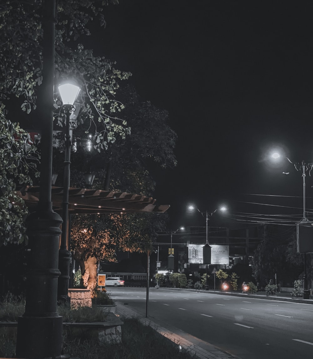 lighted street lamp near road during night time