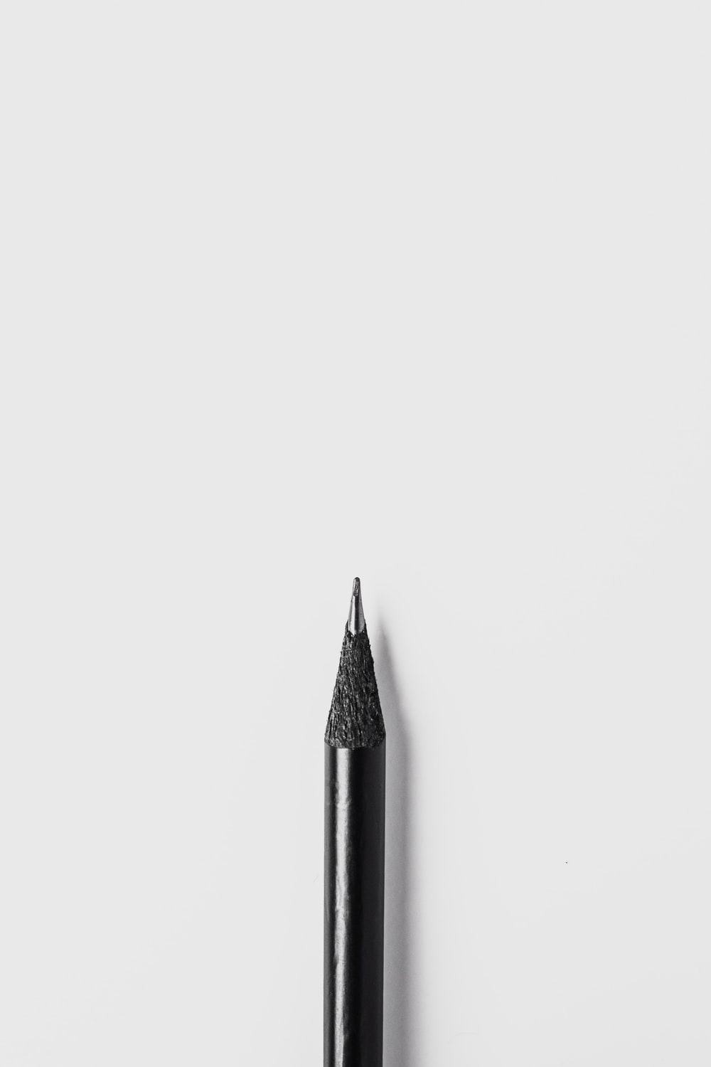 black pencil on white surface