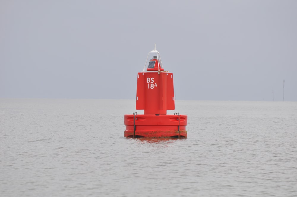 red and white ship on sea during daytime