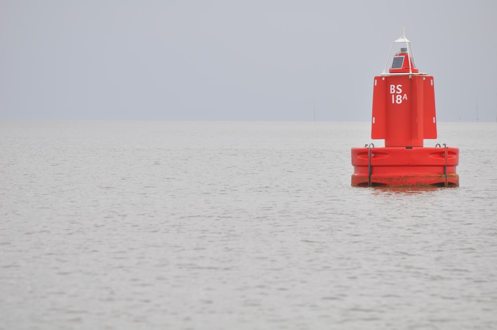 red boat on sea during daytime