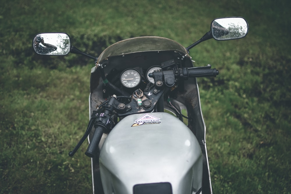black and gray motorcycle on green grass field during daytime