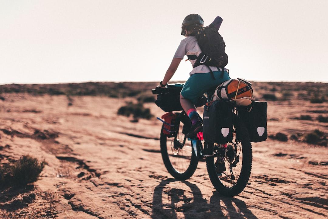 Bikepacking in the desert. Woman biking.