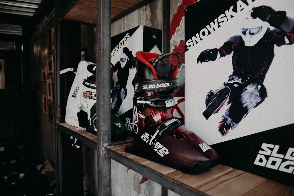 red and black motorcycle on brown wooden shelf