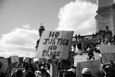 grayscale photo of people on street protest zoom background