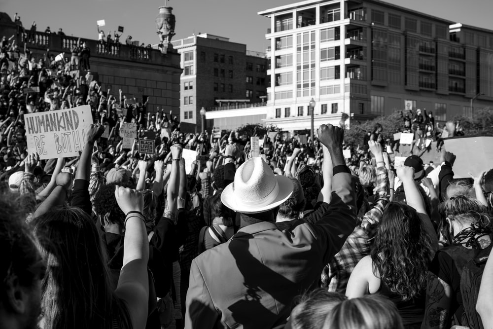 grayscale photo of people in a concert