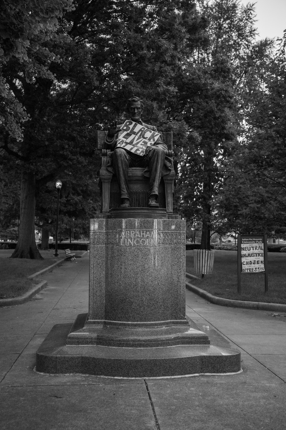 grayscale photo of statue of man