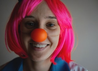 woman with pink hair wearing blue shirt