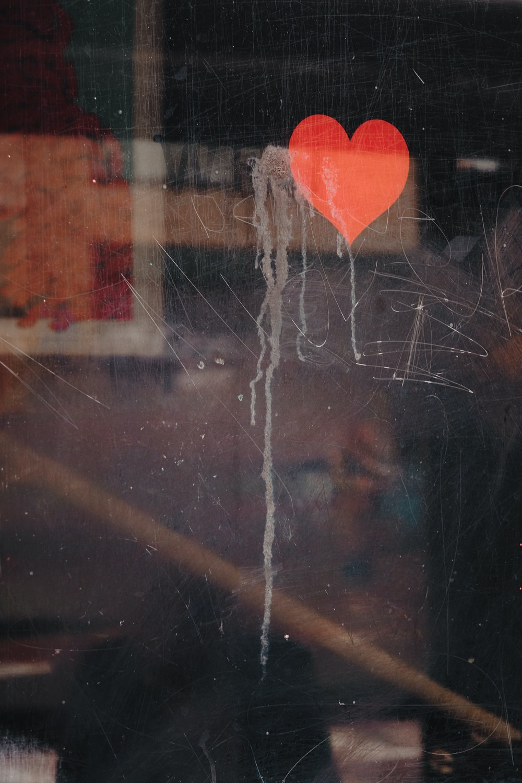 red heart on glass window