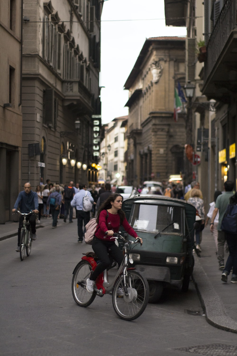 people riding bicycles on street during daytime