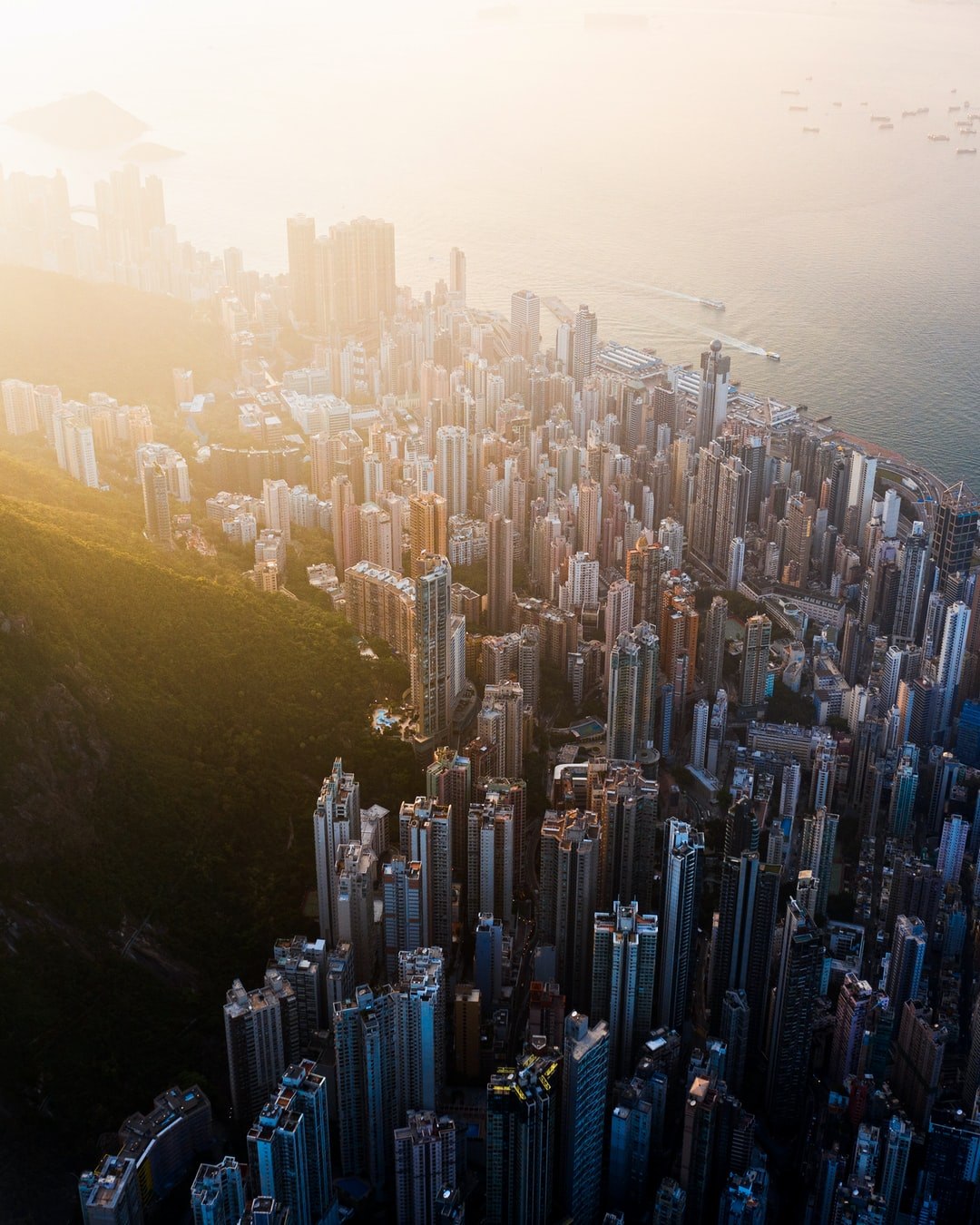 An aerial perspective of the high rises on Hong Kong Island during sunset.