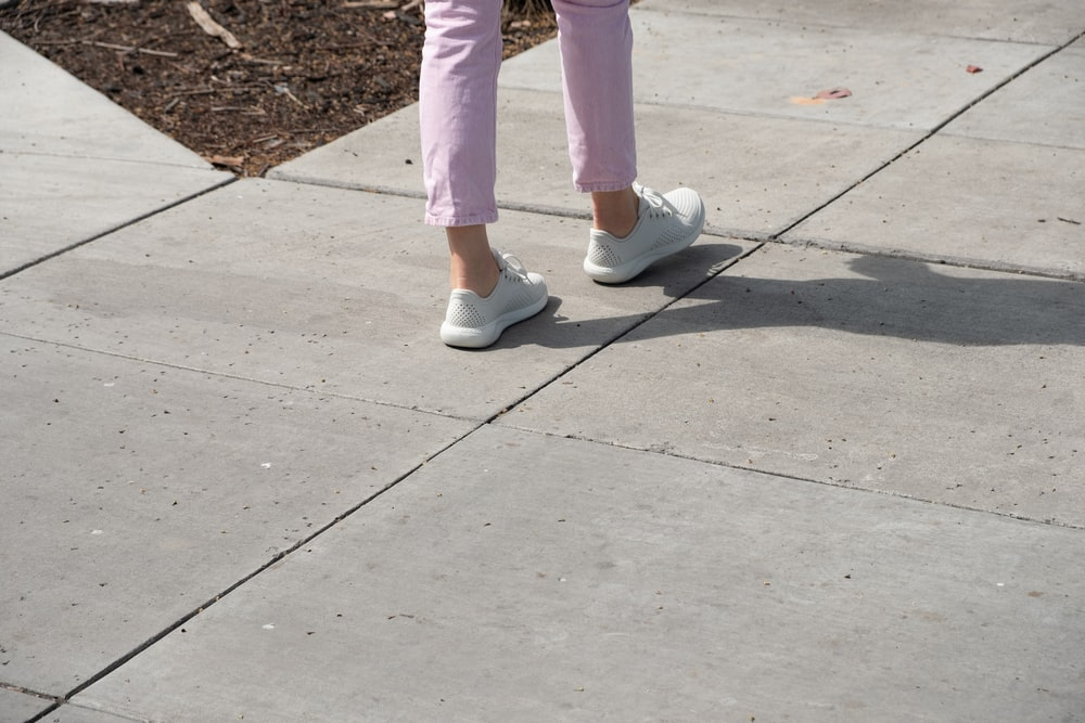 person in pink pants and white sneakers