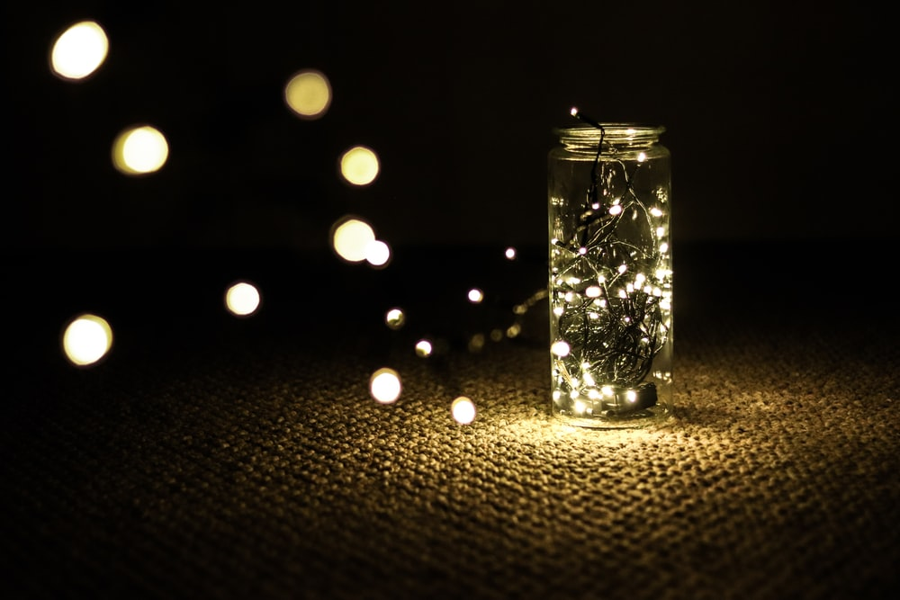 clear glass candle holder with string lights