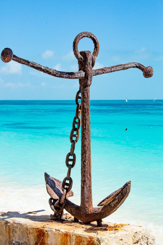 blue metal chain near sea during daytime