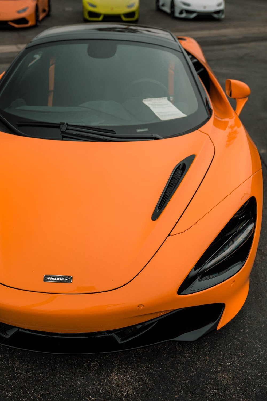 orange ferrari car on road during daytime