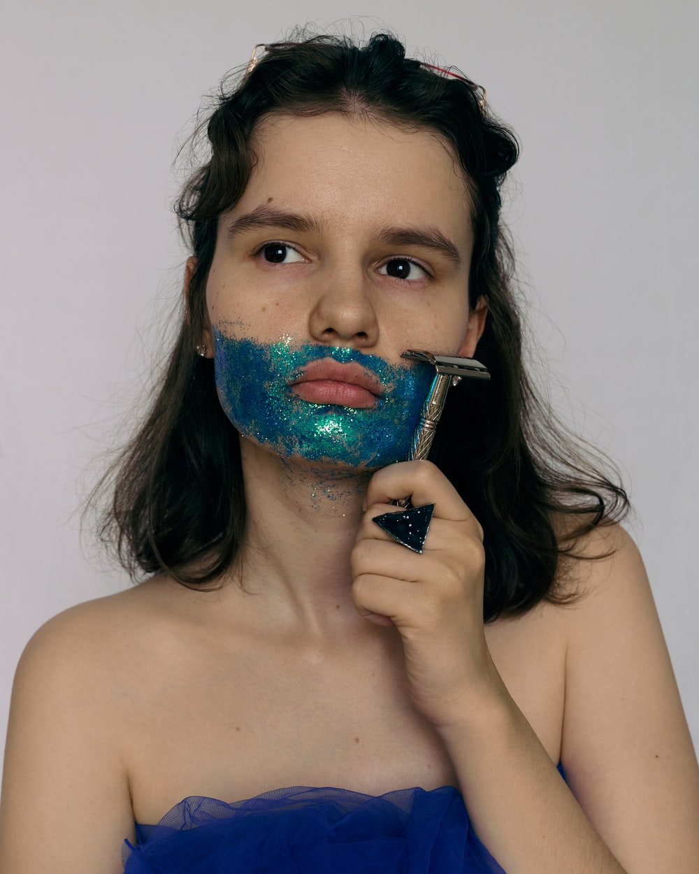 woman with blue and green paint on her face