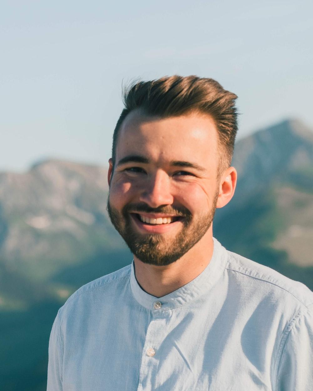 man in white dress shirt smiling