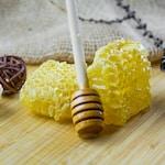 yellow and white ice cream on white textile