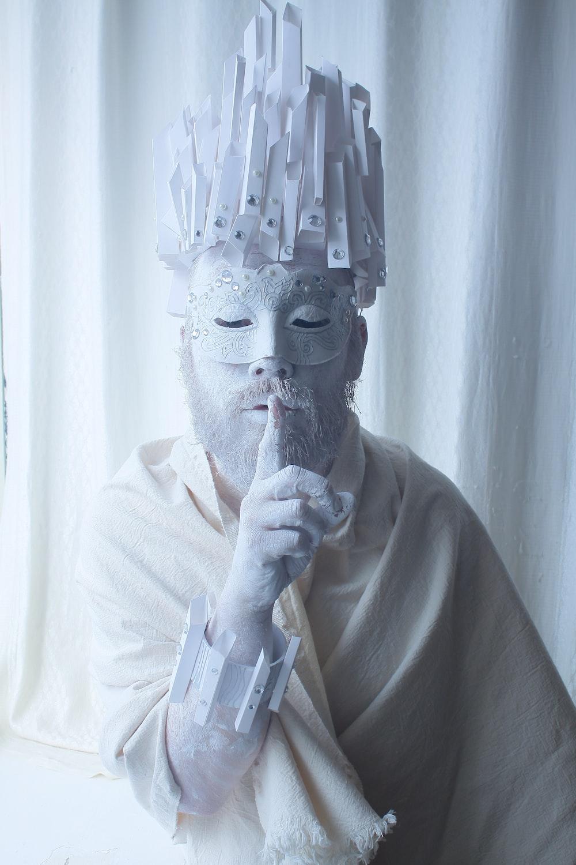 man in white dress shirt wearing gold mask