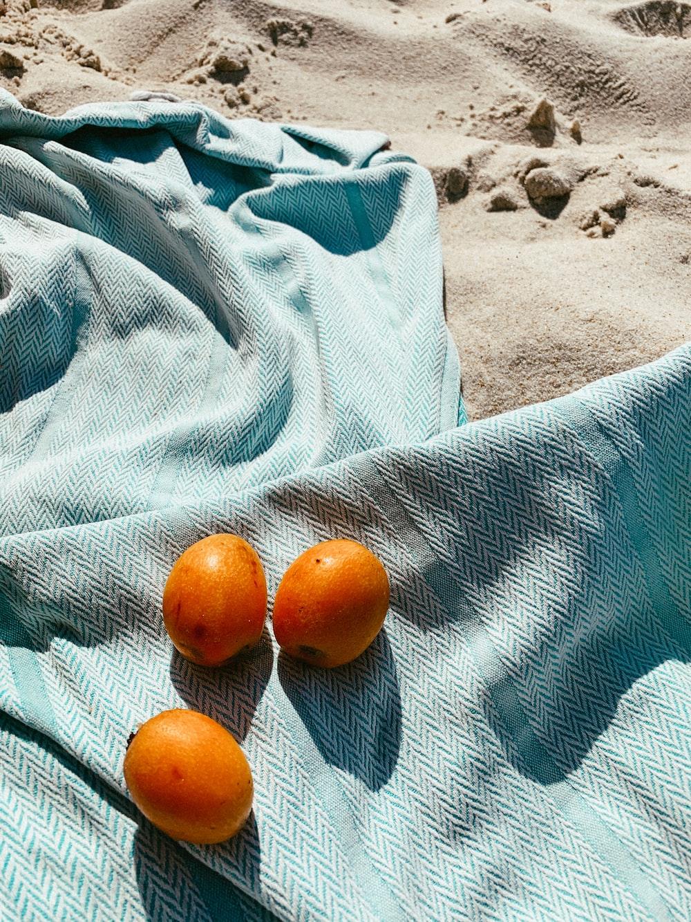 orange fruit on blue textile