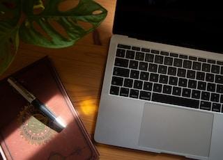 macbook pro beside black smartphone