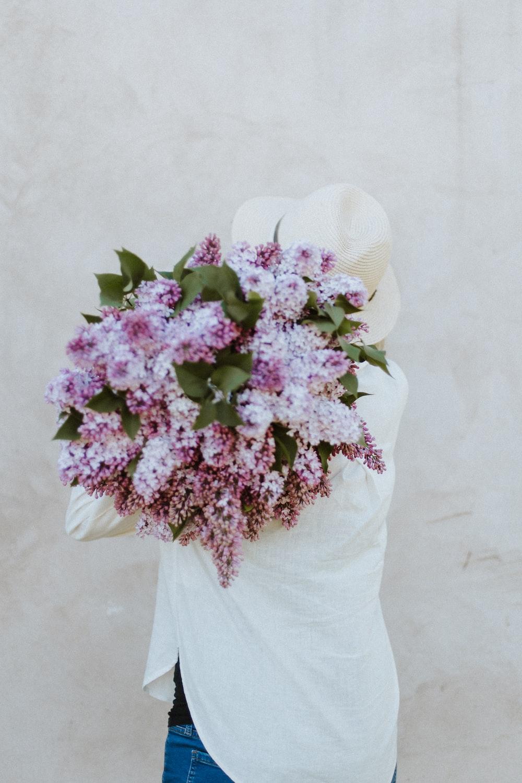 purple flowers on white hat