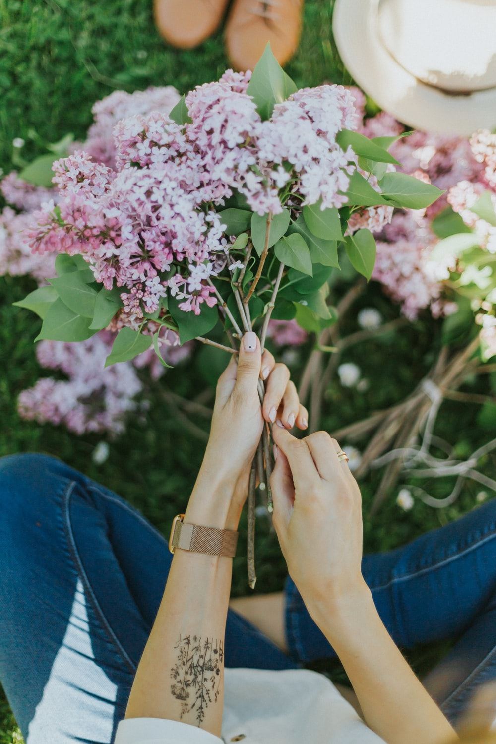 person holding purple flowers during daytime