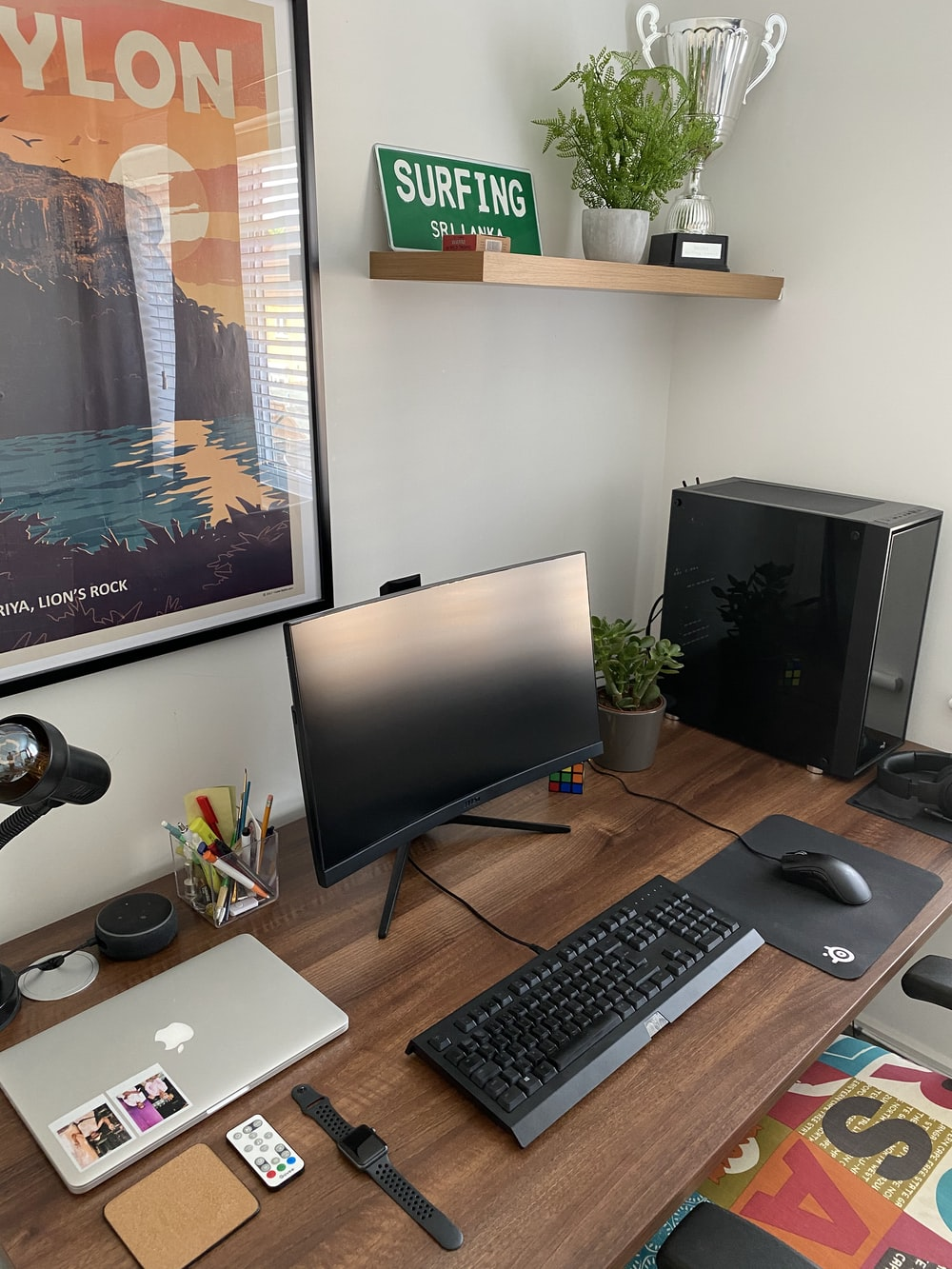 black flat screen computer monitor and black computer keyboard on brown wooden desk