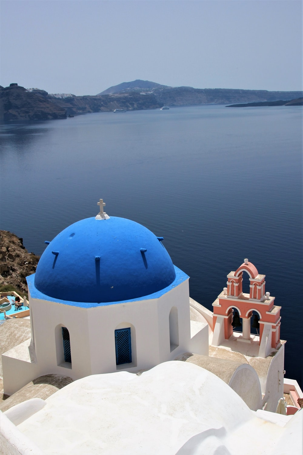 white and blue dome building near body of water during daytime