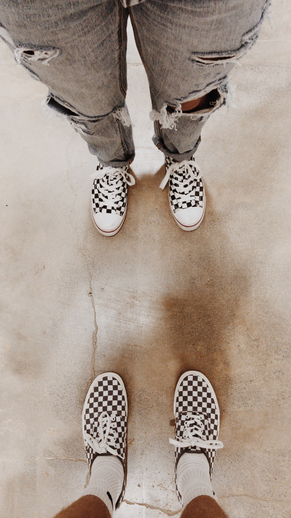person wearing white and black polka dot sneakers