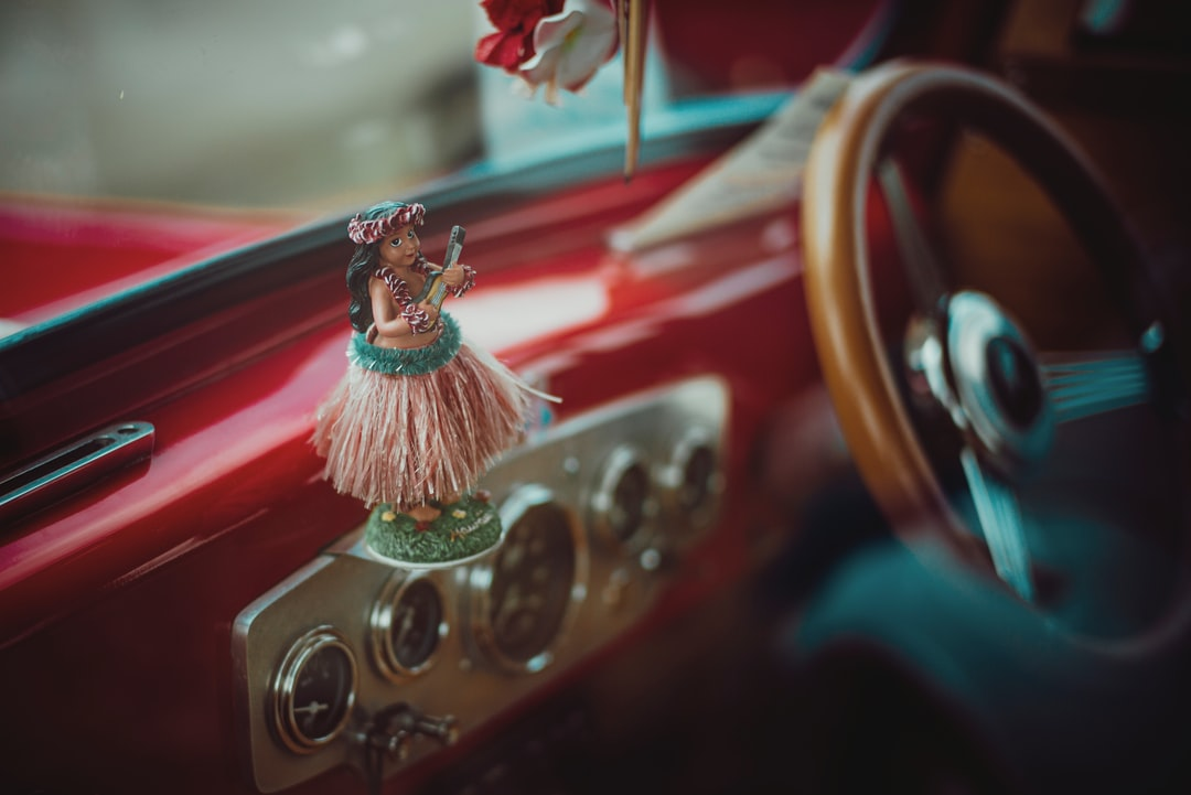 Hawaiian Dancer On A Classic Car Dashboard - unsplash