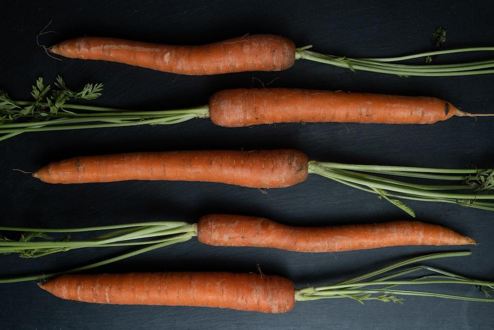 3 carrots on black textile