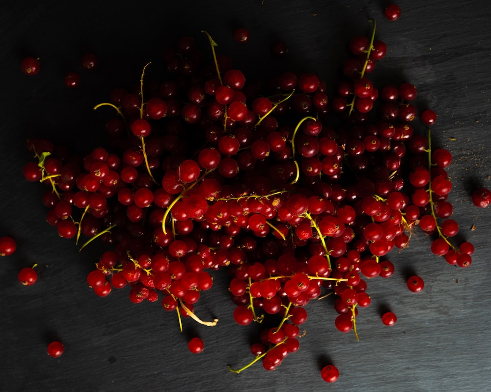 red cherries on black wooden table