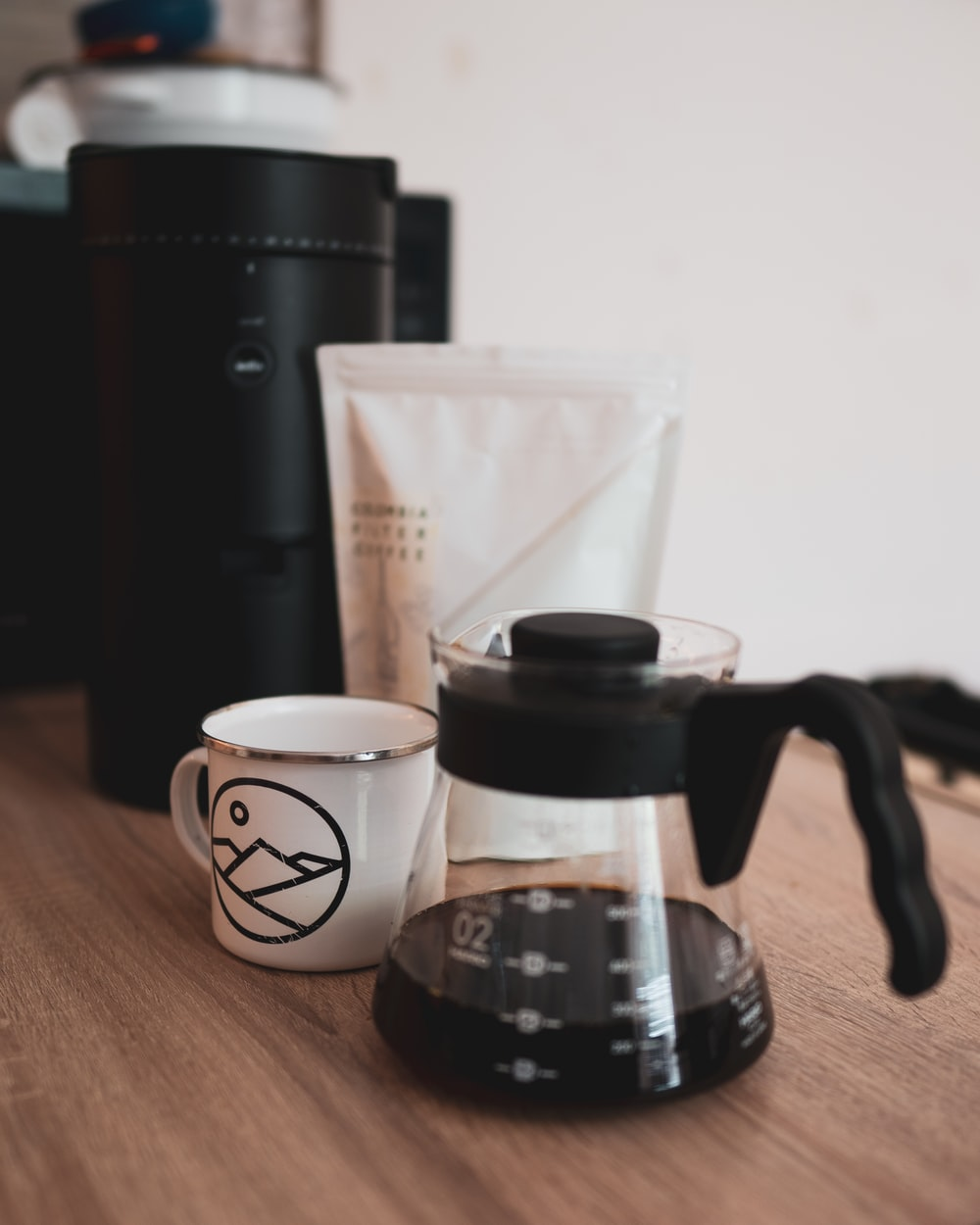 black and white coffee cup on brown wooden table