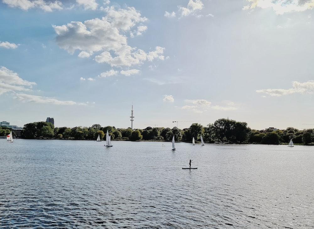 people on lake during daytime