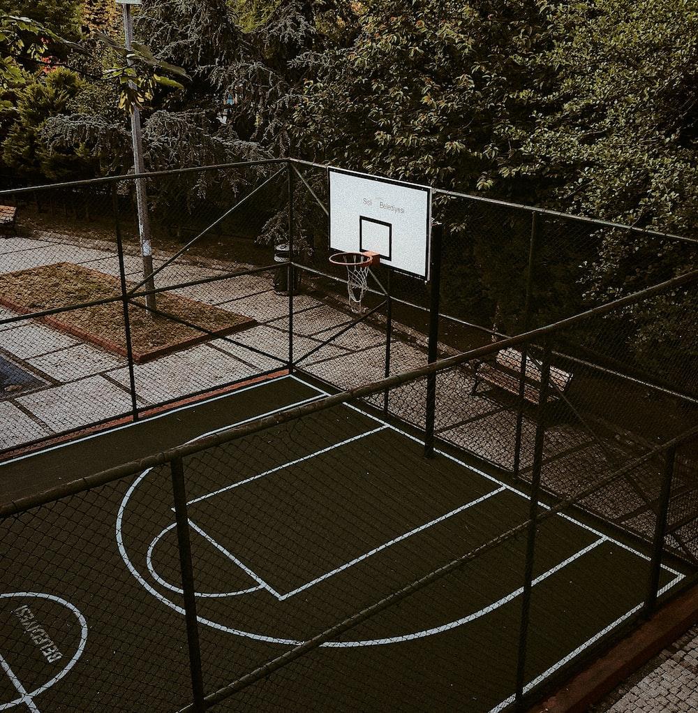 white basketball hoop on basketball court