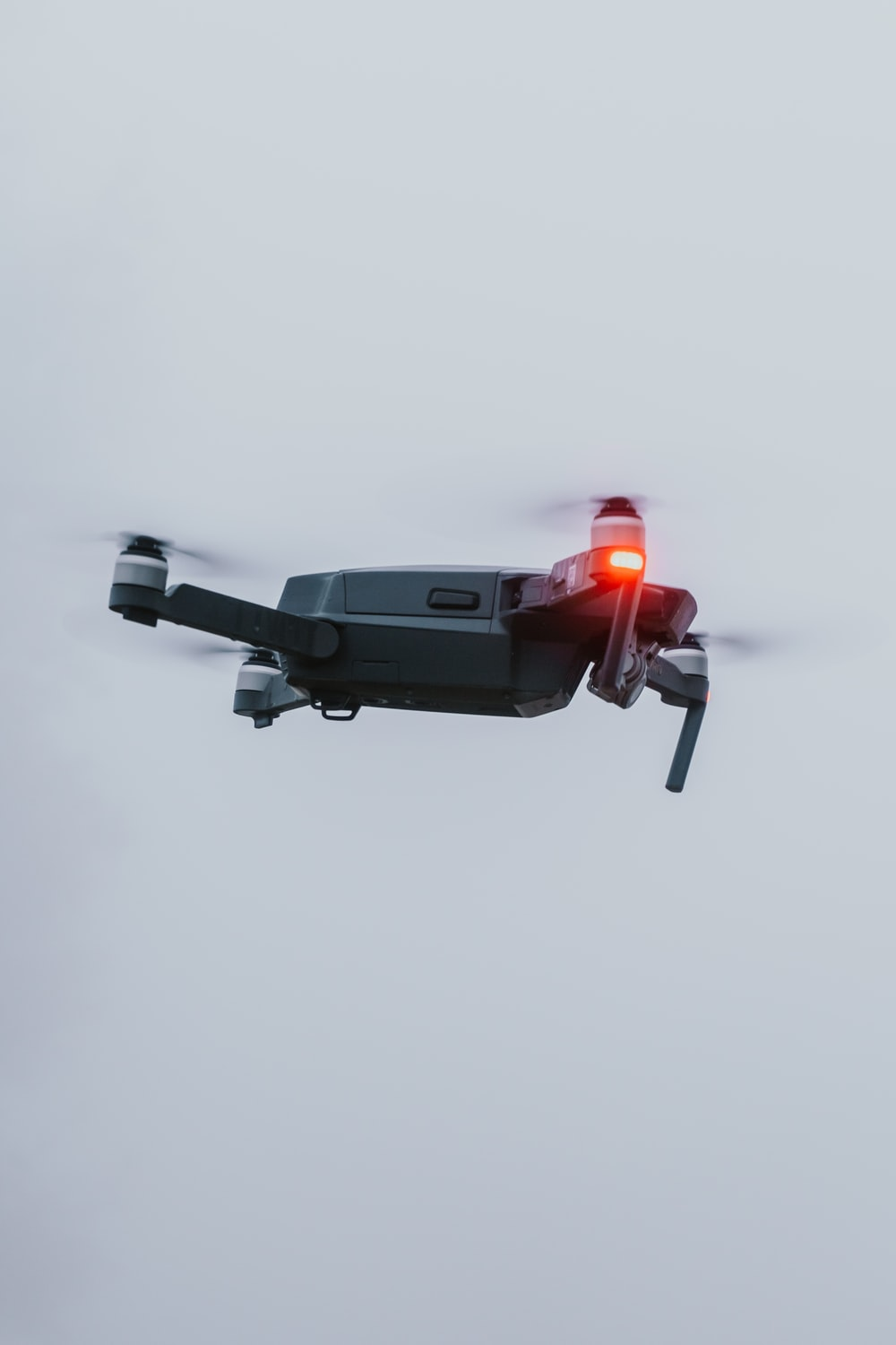 black and red drone in mid air