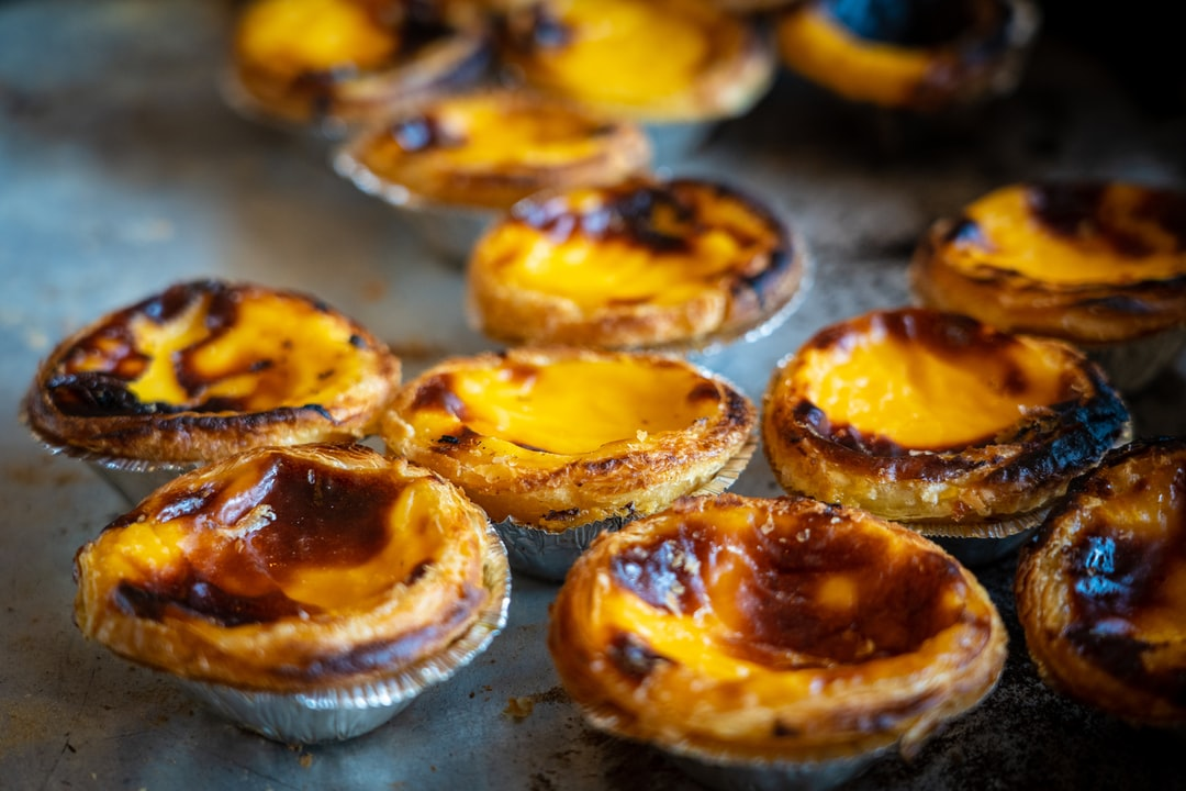 Pastel De Nata is a Portuguese egg tart pastry, dusted with cinnamon.  Our local tapas restaurant bakes them on a daily basis and they are a real treat.