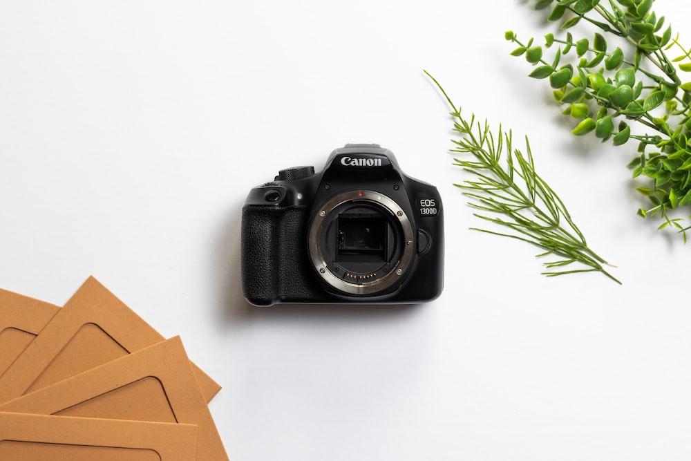 black nikon dslr camera on white table