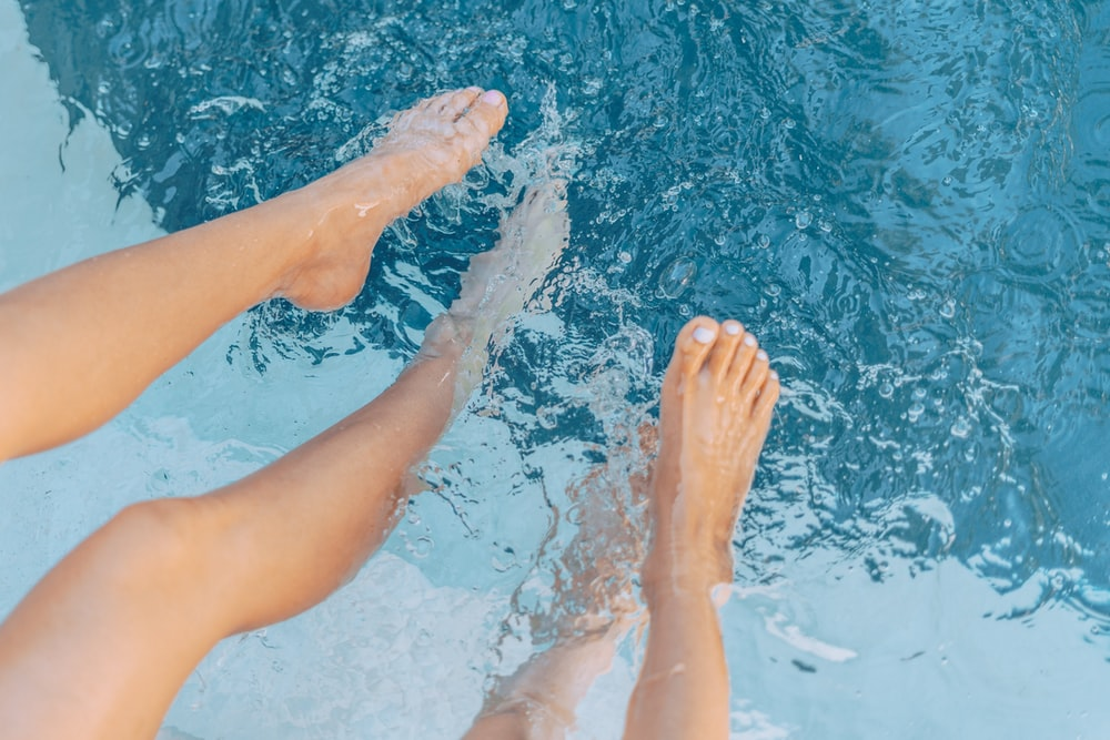 persons feet on water