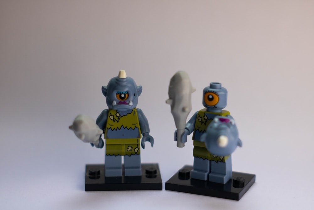 blue and yellow lego toys