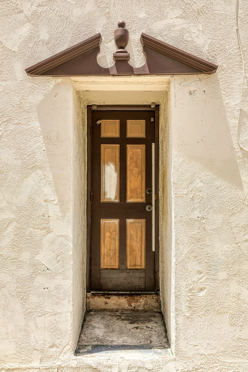 brown wooden window on white concrete wall