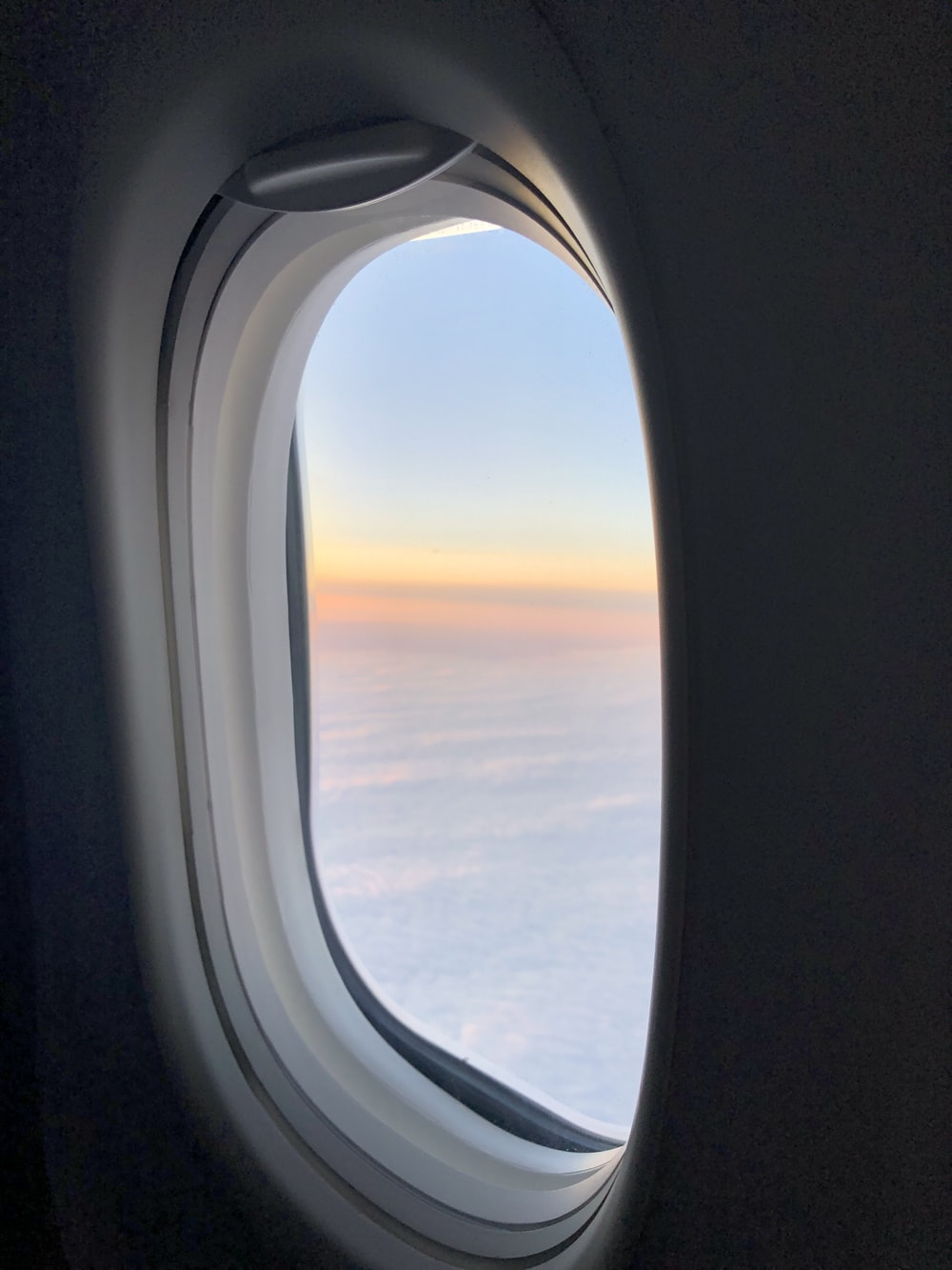 airplane window view of white clouds during daytime