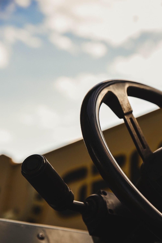black steering wheel during daytime