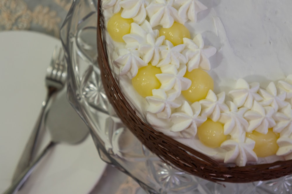 yellow and white candies in clear glass bowl
