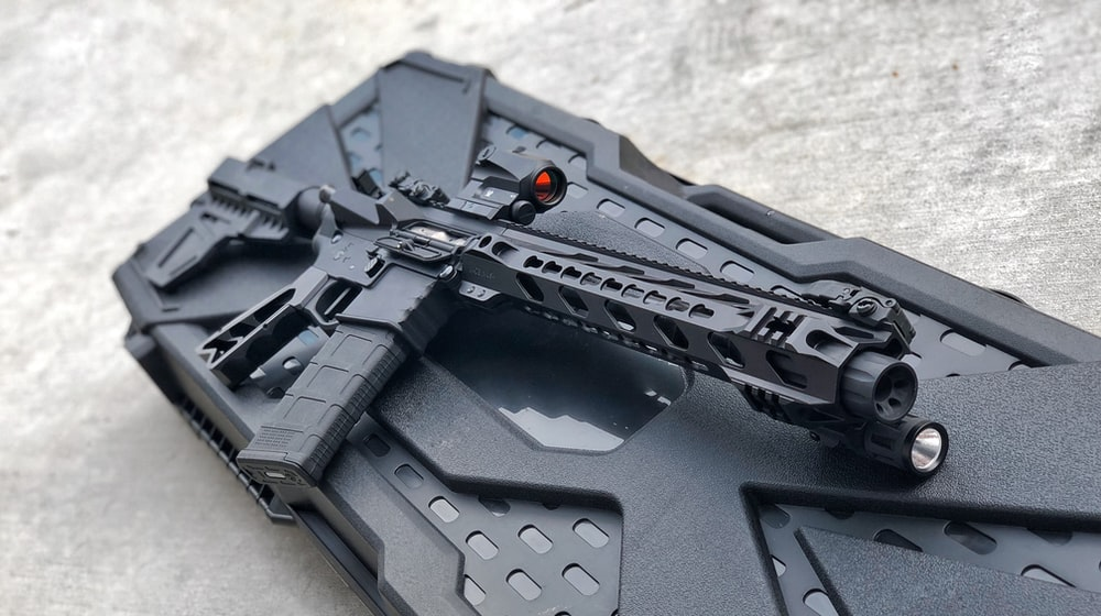 black rifle on black plastic case