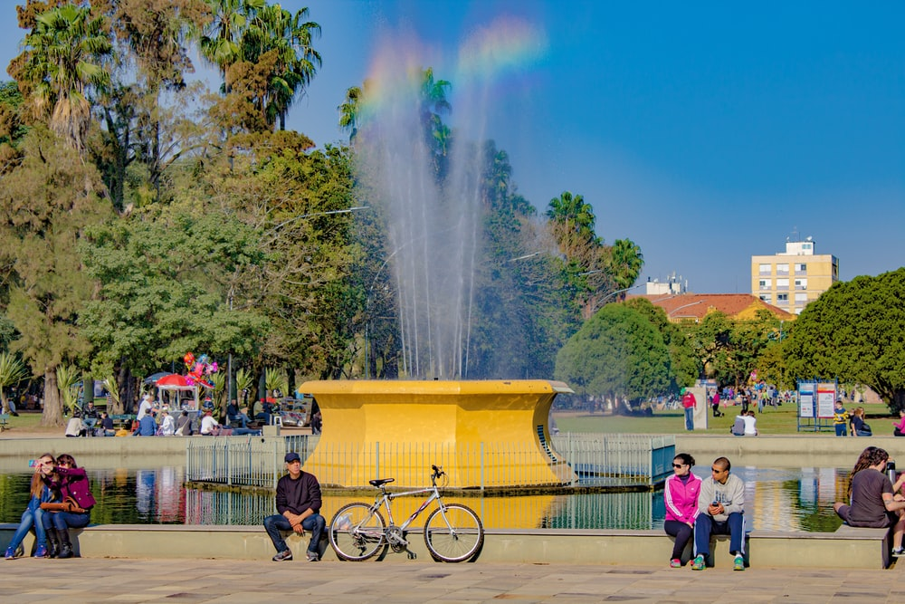 people standing near fountain during daytime