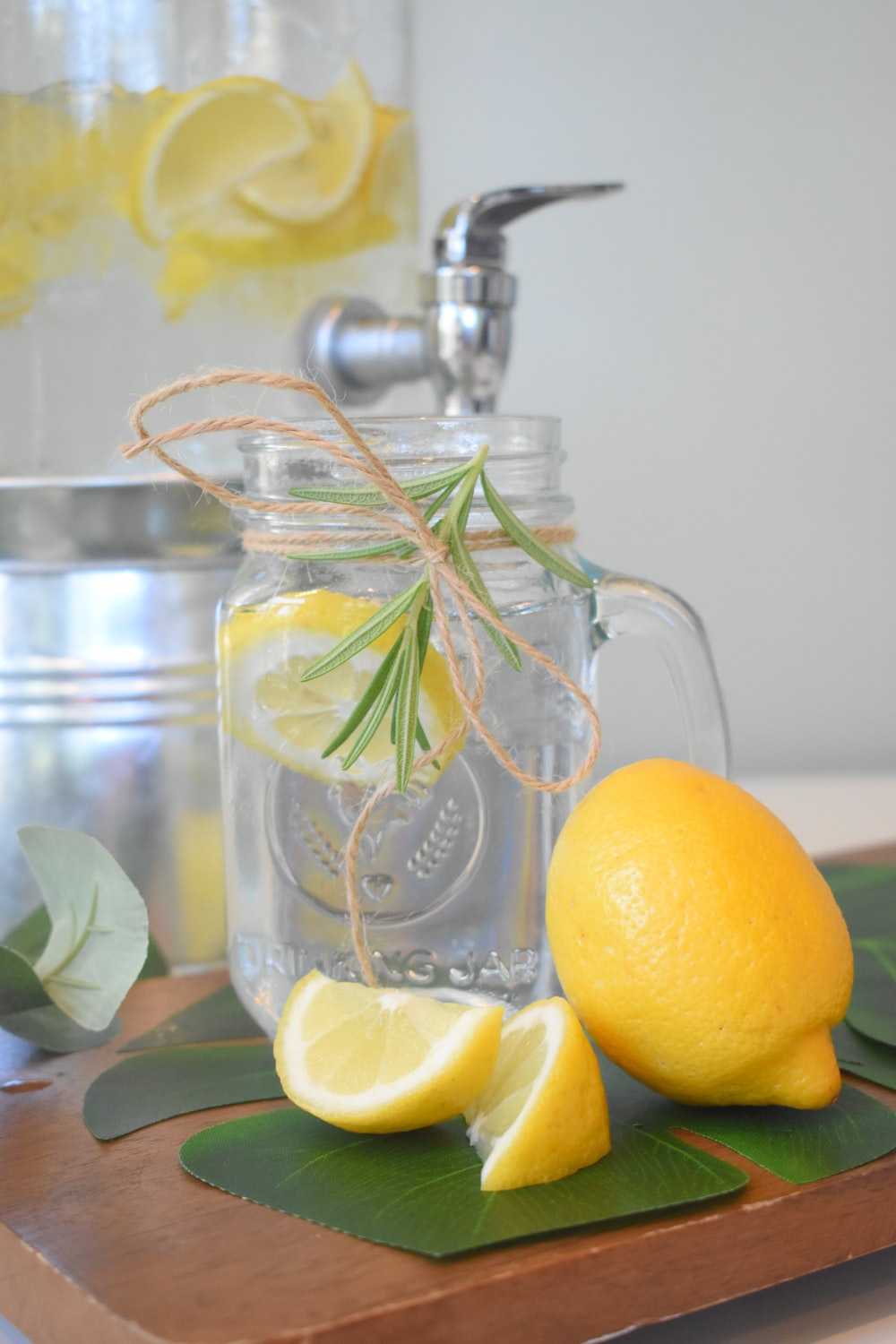 lemon fruit on clear glass pitcher