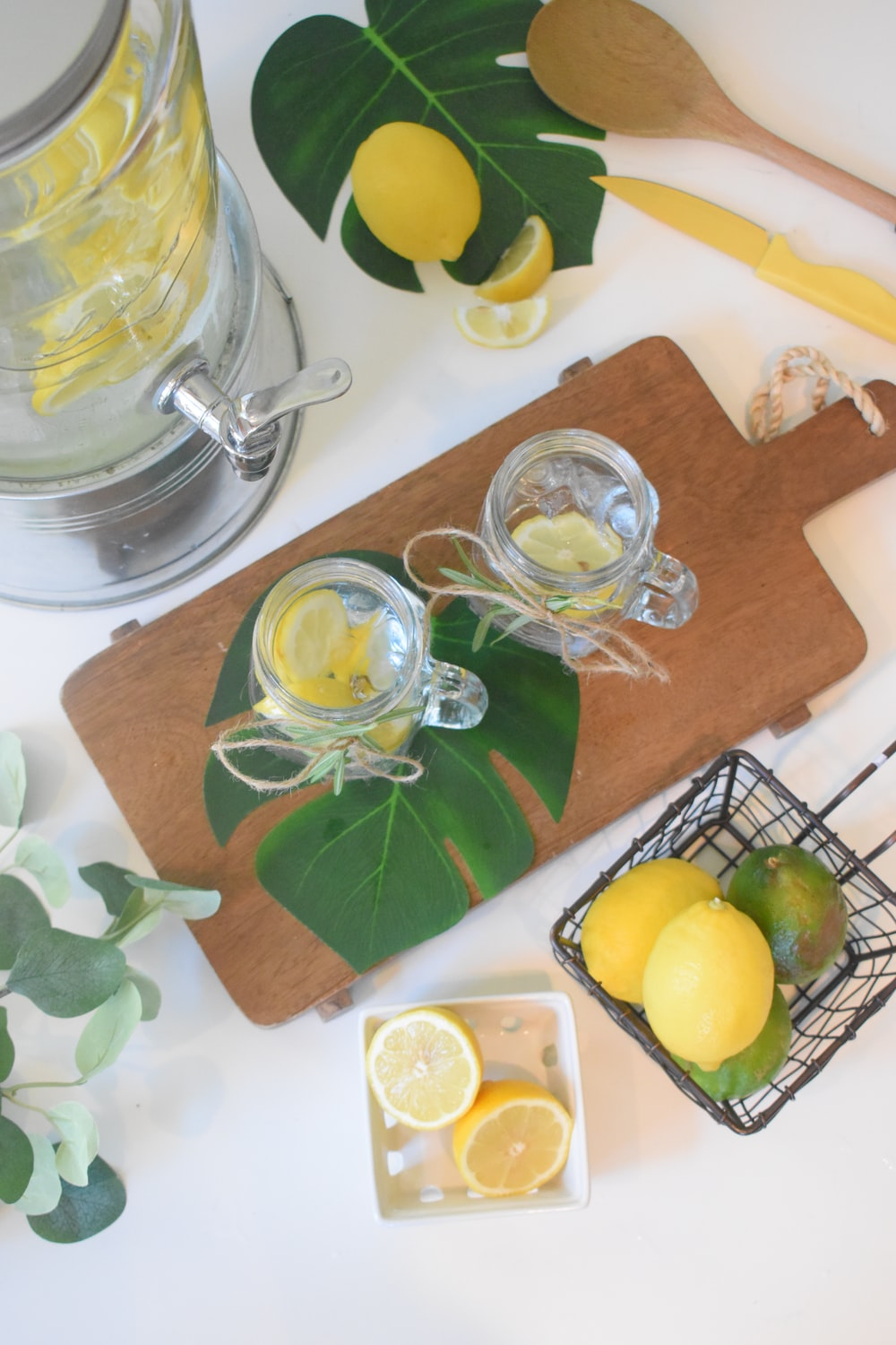 clear glass mug with lemon and water