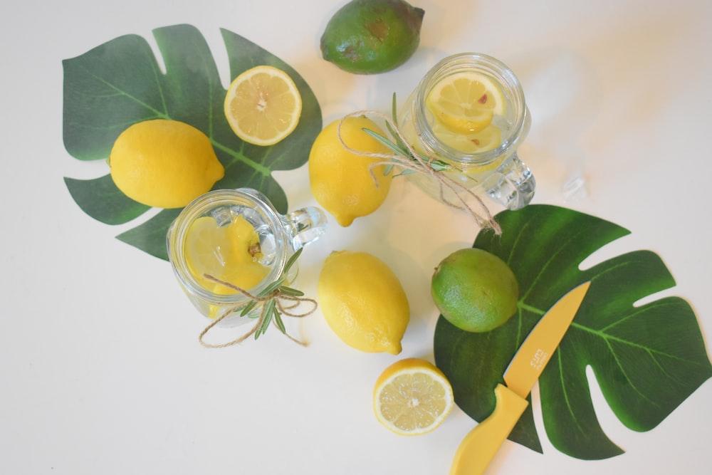 sliced lemon on clear glass jar
