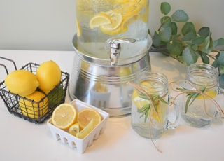 clear glass jar with yellow fruits